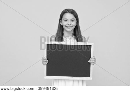 Blank Blackboard. Something You Need To Know. Happy Smiling Girl Hold Blackboard. Small Kid With Bla