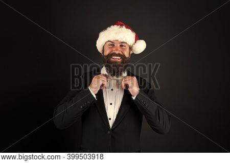 Corporate Christmas Party. Bank Worker. Man Bearded Hipster Wear Santa Hat. Christmas Spirit Concept