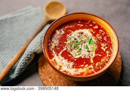 Bowl Of Homemade Creamy Roasted Tomato Soup With Fresh Herbs And Parmesan Cheese.ketogenic Low Carb