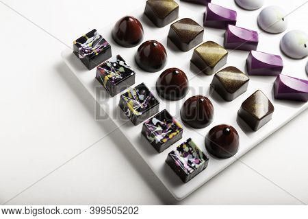 Variety Of Luxury Chocolate Handmade Candy Bonbons With Ganache On White Background. Exclusive Handc