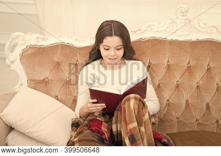 Winter Wonderland. Adorable Girl Reading Book Christmas Eve. Cozy Concept. Child Enjoy Winter Holida
