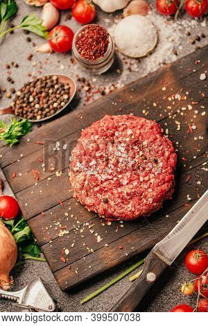 Round Ground Beef Portioned Beef Patty Made From Beef Mince On A Wooden Board. Hamburger Meat Season