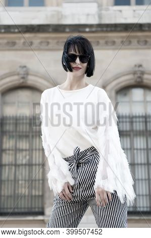 Stylish And Comfortable. Woman Fashionable Model Posing Outdoor. Girl Brunette Bob Hairstyle Looks S