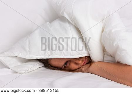 Woman Sleeping Under White Blanket. Fight Against Insomnia. Tired And Exhausted Person Had Nightmare
