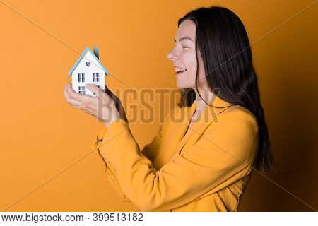Buy A House, Take Out A Bank Loan Or Save Up Your Money. Real Estate Investment, Concept. A Young Wo