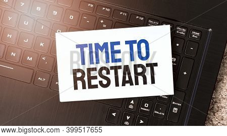 White Paper Sheet With Text Time To Restart On The Black Laptop