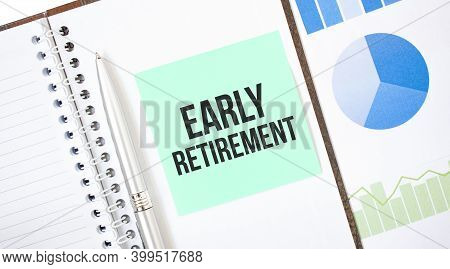 Green Card On The White Notepad. Text Early Retirement. Business Concept
