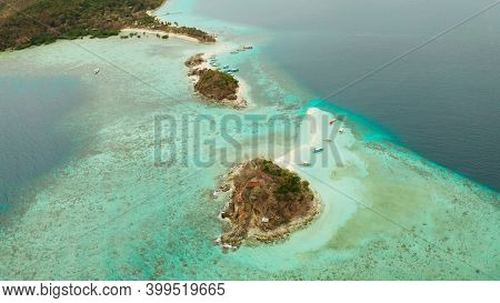 Aerial Seascape Island With White Beach. Bulog Dos, Philippines, Palawan. Tourist Boats On Coast Tro