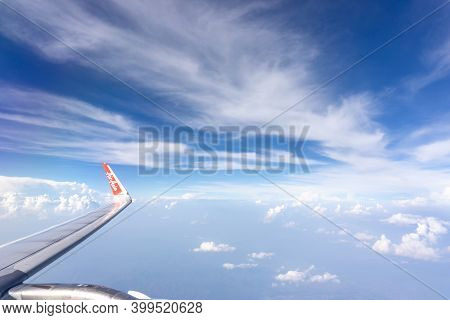 Bangkok, Thailand-may 23, 2019: Sky Scape View From Clear Glass Window Seat To Aircraft Wing Of The