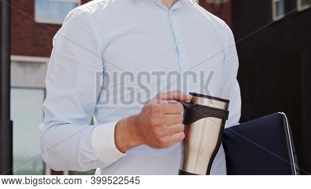 Young And Attractive Freelancer Walking Outdoor. Office Worker Or Businessperson. Business And Real