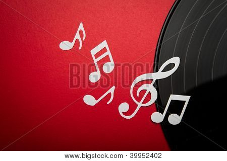 Paper  cut of music note on Black vinyl record lp album disc with copy space for text or design