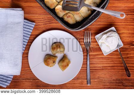 Mantije ( Manti ) - Balkan Cuisine Filled Pastry On A Rustic Table Served With Creme Fraiche Or Yogu