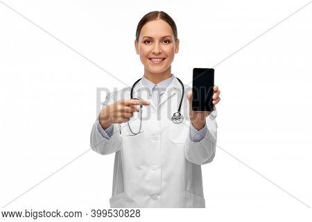 medicine, profession and healthcare concept - happy smiling female doctor or nurse with stethoscope showing smartphone over white background