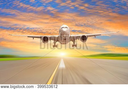 Flying Plane Before Landing On The Runway Evening Sunset Scenic Beautiful Sky On The Background