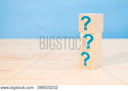 Cubes With Blue Question Marks On Wooden Background, Closeup. Space For Text. Questions Mark Word Wi