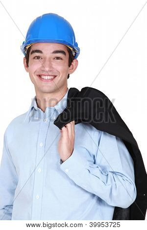 Young architect holding jacket over shoulder