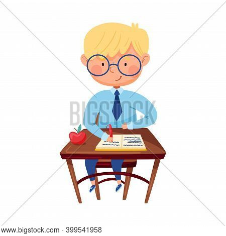 Clever Boy Sitting At Desk At School Lesson And Writing In Copy-book With Pen Vector Illustration
