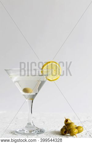 Martini With Lemon. Martini Glass With Cocktail And Olives On White Background. Cocktail Margarita W