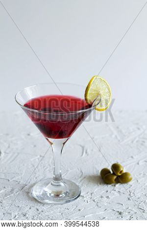 Cosmopolitan Cocktail. Martini Glass With Cocktail And Olives On White Background. Red Cocktail With