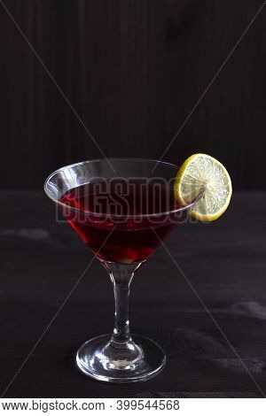 Cosmopolitan Cocktail. Martini Glass With Cocktail And Olives On Black Background. Red Cocktail With