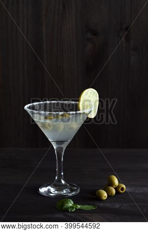 Cocktail Martini. Martini Glass With Cocktail And Olives On Black Background. Cocktail With Lime And