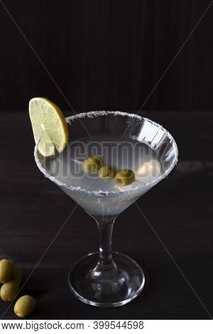 Cocktail Martini. Martini Glass With Cocktail And Olives On Black Background. Margarita Cocktail Wit
