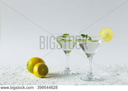 Alcohol Drinks. Two Martini Glasses With Cocktail And Ice On White Background. Cocktail Margarita Wi