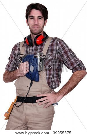 Man with an electric saw