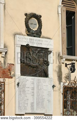 Venice, Italy - Sept 26, 2014: View Of War Memorial On Palacio Facade In Venice. Memorial Was Built