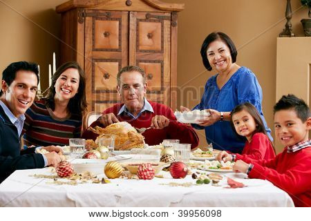 Multi Generation Family Celebrating With Christmas Meal