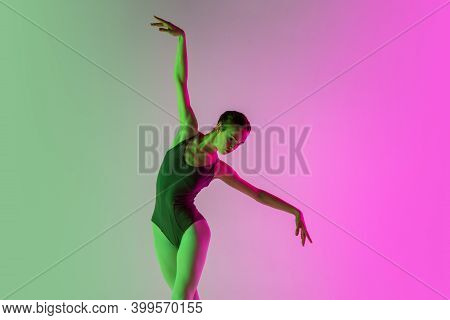 Fly. Young And Graceful Ballet Dancer Isolated On Gradient Pink-green Studio Background In Neon. Art