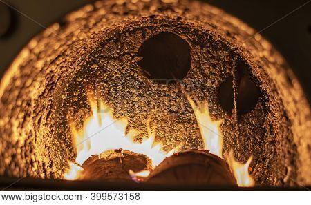Tar Deposit Inside The Wood Fuel Boiler. Shinny Black Deposit Inside The Solid Fuel Boiler. Creosote