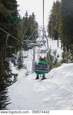 Man With Ski On The Chairlift, Traveling To The Seven Rila Lakes, Bulgaria.