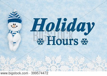 Holiday Hours Message With A Happy Snowman With Blue Snowflakes
