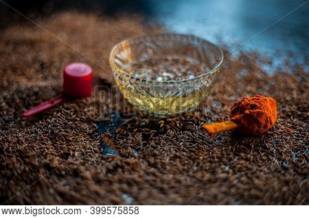 Diy Face Mask For Smooth And Glowing Skin. Shot Of Cumin Seeds Along With Some Turmeric On A Brown S