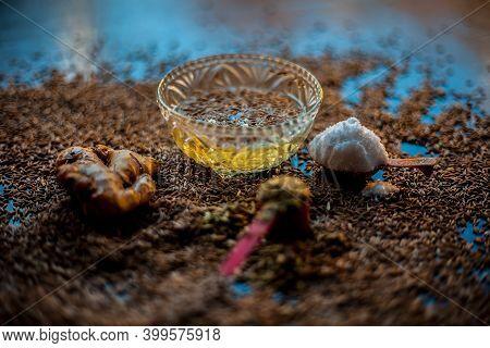 Shot Of Cumin Seeds, Sea Salt, Ginger Powder,fennel Seeds On Brown Surface For Curing Bloating.