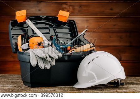 Open Plastic Tool Kit Box With Construction Safety Helmet And Various Hand Tools.