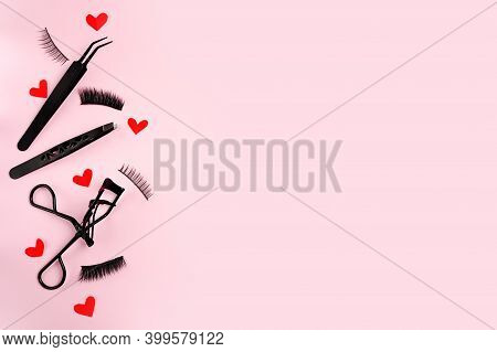 Lash Curler, False Lashes And Tweezers For Eye Make-up On Pink Background With Red Hearts , Copy Spa