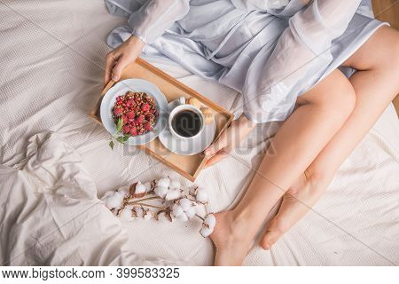 Man Bringing Woman Breakfast In Bed  To Celebrate Wedding Anniversary. Breakfast In Bed In Living Ro