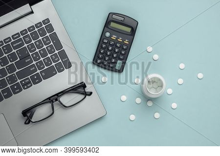 Economic Calculation Of The Cost Of Treatment, Analysis Of The Cost Of Medicines. Bottle Of Pills, L