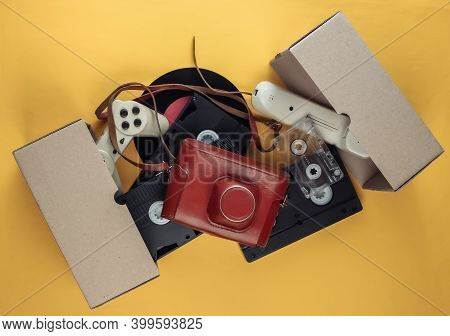 Cardboard Box With Video Cassette, Retro Film Camera, Gamepad,  Vinyl Record, Phone Tube, Audio Cass