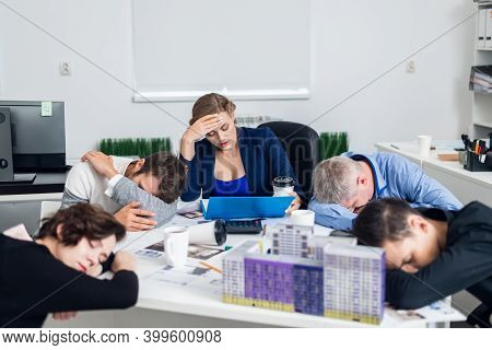 Bored Or Tired Business People Sleeping, Resting On Their Workplace During The Meeting, A Concept Of