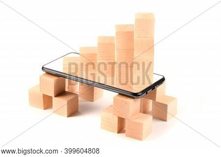 Black Mobile Smartphone And Wooden Cubes. Smartphone With Blank Screen. Isolated On White Background