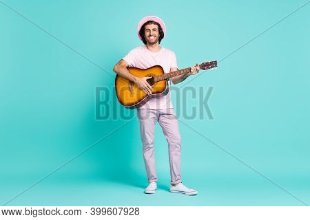 Full Length View Of Handsome Cheerful Soloist Playing Solo Guitar Having Fun Isolated On Teal Color