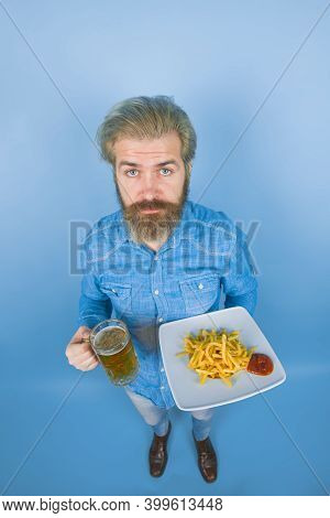 Street Food. Fast Food. Man With Potato Fries. Beer. French Fries Potato. Man Drinking Beer And Eati