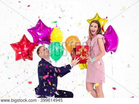 Happy New Year 2020,the Young Man Is Giving A Gift To His Girlfriend