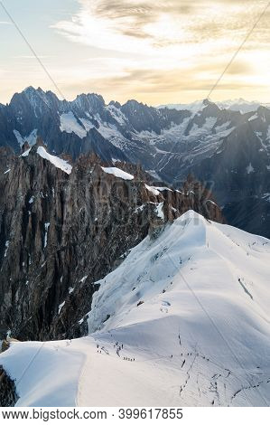 Climbers Chain On A Snowy Mountainside Of Mont Blanc Massif