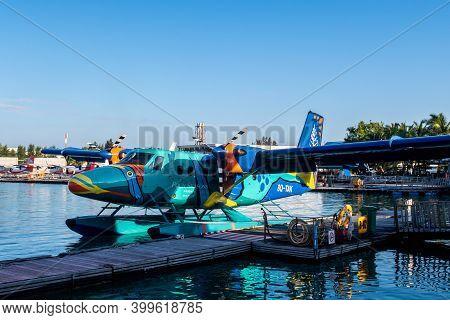 Male, Maldives, 20.11.2020. Trans Maldivian Airways Colorful Seaplane Twin Otter Series 400 Docked A