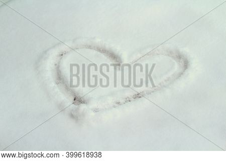 A Heart Drawn In The Snow, Winter White Background. Concept Of Love, Romance, Wedding, Valentines Da