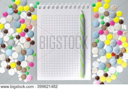 Various Medical Pills, Notepad And A Pen